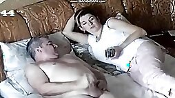 Mature couple is filmed with a hidden cam while having fun