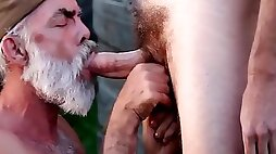 Mature man sucking cock outside