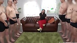Japanese MILF in a dress gets on her knees to suck a hard cock