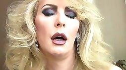 Mature blonde shemale enjoys solo masturbation in her black lingerie