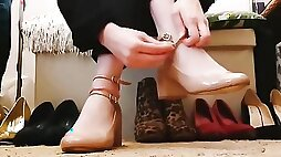 Lovers of foot fetish will enjoy an amateur lady trying on various shoes
