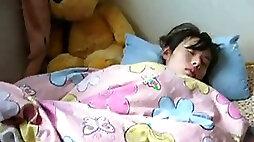 Sleeping Japanese girl gets her hairy twat examined