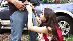 Adorable girl gags on strangers dick in car and near it