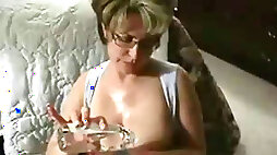 Adorable and elegant busty blonde milf loves giving titjob