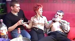 During a party a redheaded MILF takes on four guys at once