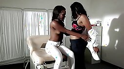 Ebony doctor and her sexy patient eat pussy on the exam table