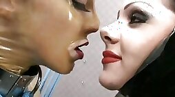 Horny German chicks in latex licking each other pussies