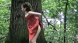 Frontal view of a wedding guest pissing