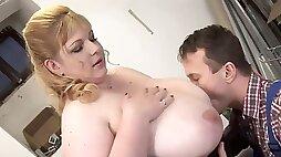 Blonde mature BBW seducing mechanic with her huge tits
