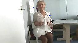Attractive Granny in Short Skirt Strips
